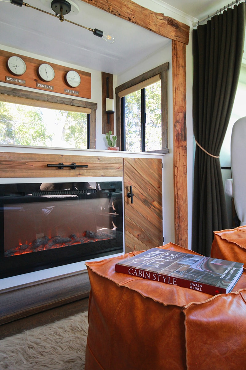The book Cabin Style on faux leather ottoman inside RV