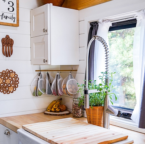 Modern farmhouse Kitchen inside converted school bus designed by @happyhomebodies