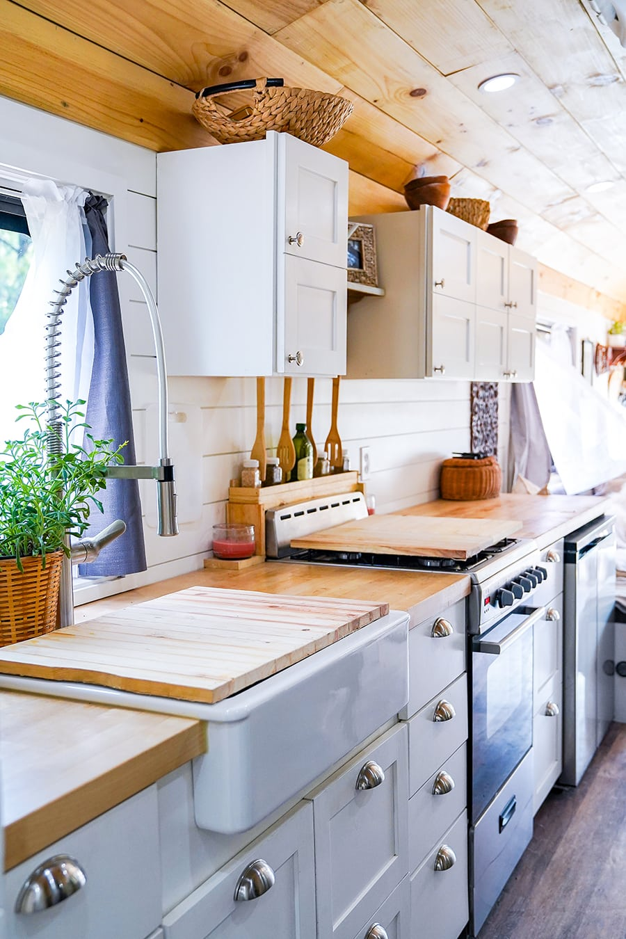 amazing tiny kitchen design inside converted school bus @happyhomebodies