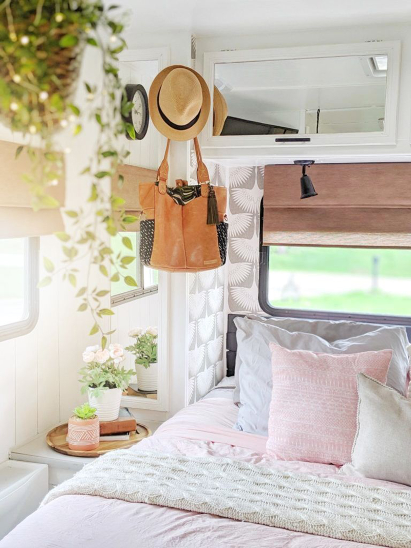 Renovated RV with white and pink bedroom