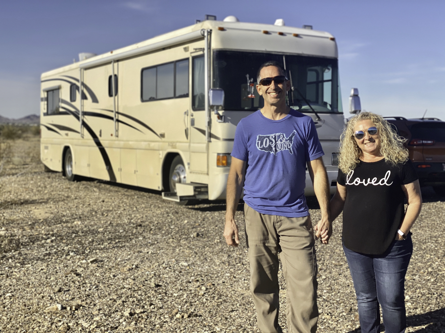 Marc and Julie of RVLove in front of their renovated RV