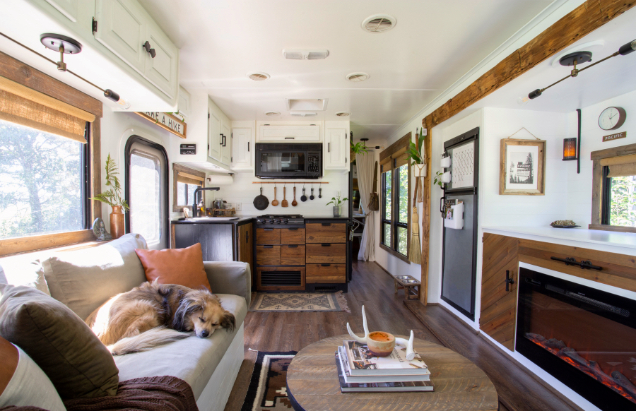 modern rustic RV with dog sleeping on sofa
