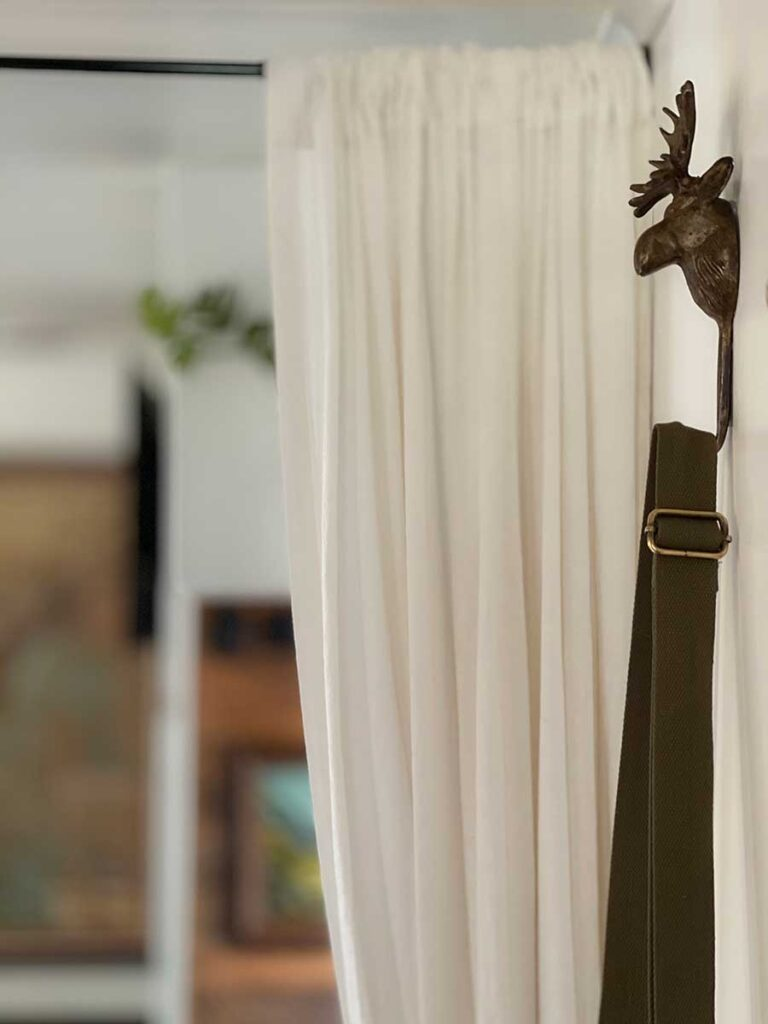 moose hook with purse hanging from it