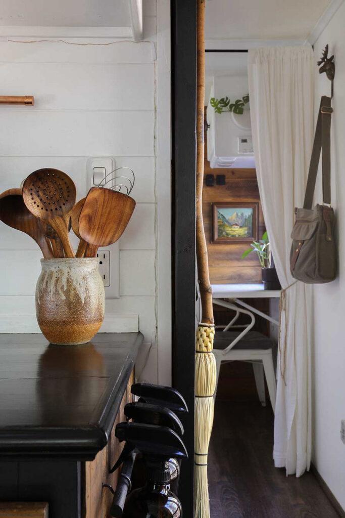 ceramic pot with wooden utensils