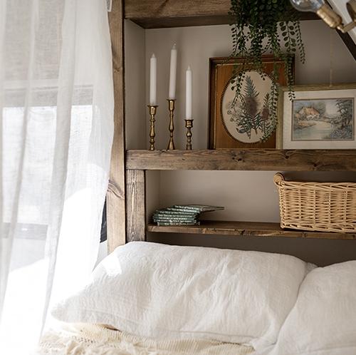 cozy vintage-inspired bed nook in camper