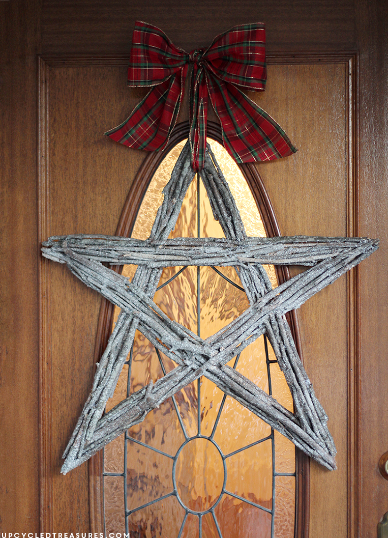 See how easy it was to make this Christmas Twig Star Wreath. The perfect rustic touch to your holiday decor. MountainModernLife.com
